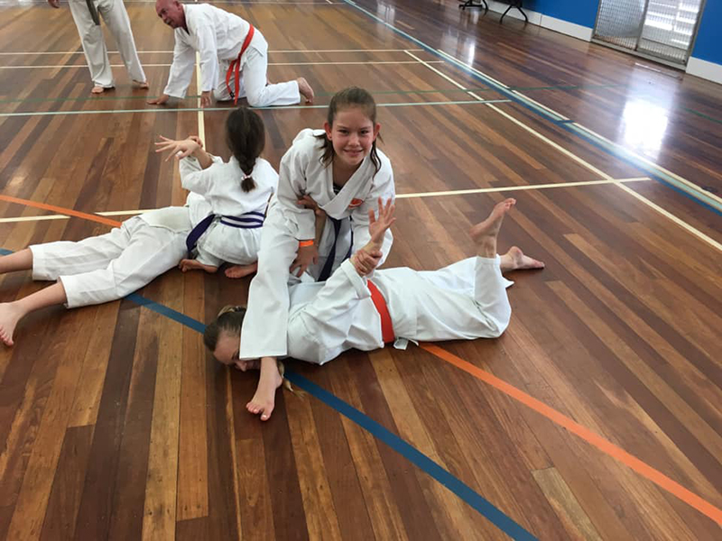 Family martial arts training in Helensvale